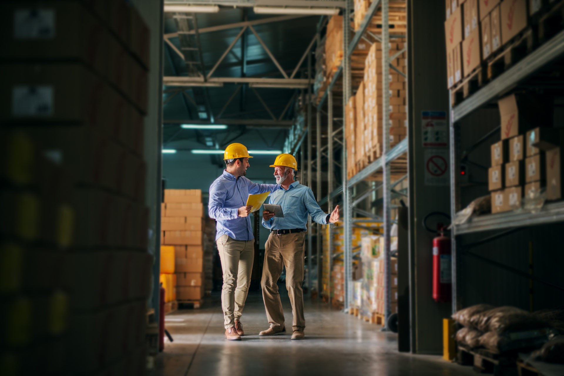 Two business man standing in warehouse