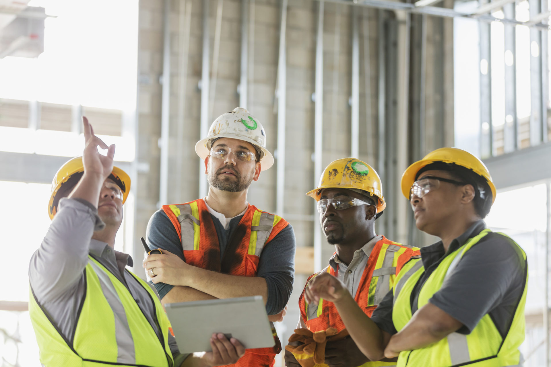 Construction Workers Discussing West Michigan IT Companies Offering Cloud Services